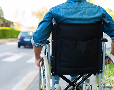 image of the back of a person sitting in a manual wheelchair